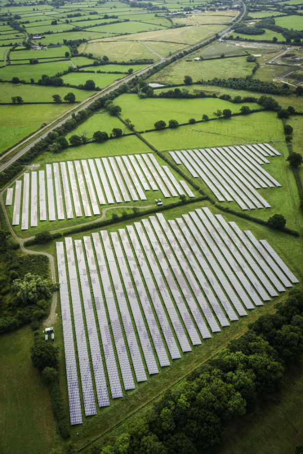 Aerial view over solar farm photovoltaic power station solar panels